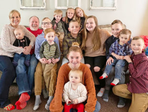 Kathryn and Gary Smith surrounded by their 13 grandchildren.