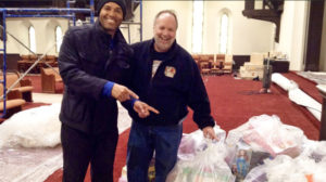 Gary Smith donating 500 toys to Mariano Rivera after the Yankee Hall of Famer established a church in New Rochelle in 2014.