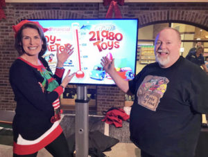 Rebecca Leclair and Gary the Happy Pirate reveal the total number of toys collected during 2019 Toy Drive-- 21,980.