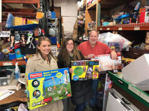 Gary the Happy Pirate with Marissa Andris and Jessica Roth dropping off toys collected at a holiday toy drive at their company, ConServe in 2016.