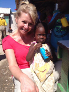 Ginny Ryan covering a story at an orphanage in Haiti in February 2015