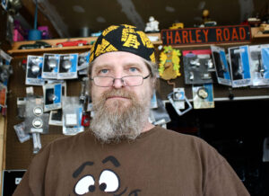 Ray J. Delue, 54, owner of Ray J's, a corner shop selling parts and accessories for American motorcycles in Newark.