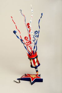 """American Spirit Rising"" depicts a patriotic popper created for a juried exhibit. Made of maple, compressed polystyrene, brass, molding paste, paint. Photo provided."