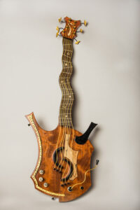 """Badda Bubinga"" is a decorative guitar inspired by the styles of Pablo Picasso and Jimi Hendrix. Made of ebony, holly, spalted maple and bubinga woods, brass, gold leaf. Photo provided."