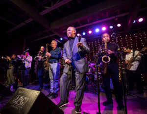 Prime Time Funk members are, from left, Derrick Lipp (trumpet), Ron D'Angelo (trumpet), Mike Edwards (baritone sax), Vince Ercolamento (tenor sax), Ronnie Leigh (vocalist), Jim Richmond (tenor sax), Ron France (bass). Out of frame are Andy Calabrese (keyboards) and David Cohen (drums). (Courtesy Aaron Winters)