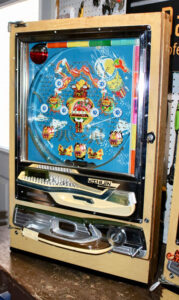 Welch shows off a special Pachinko model in his house. Some rare machines, like this one, are worth more than $2,000, but most are valued about a quarter of that. This Pachinko has a double jackpot at its core that lights up an internal roulette wheel, which turns until the player triggers a release that boosts the jackpot payoff. Other special machines have all kinds of things going on at their core.