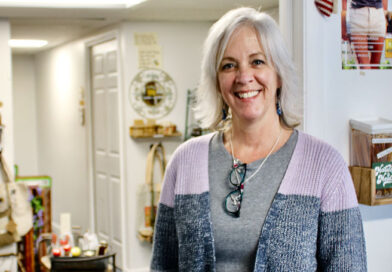 """Amy Stringer, 55, of Ontario, quit her job as an accountant for a Victor firm to open her business, The North Bee in Webster. """"I have a joy doing this,"""" she says."""