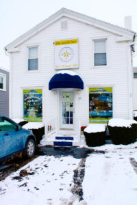 Façade of The North Bee, which opened two years ago in Webster. Top photos show variety of products available at the store — all bee-related.