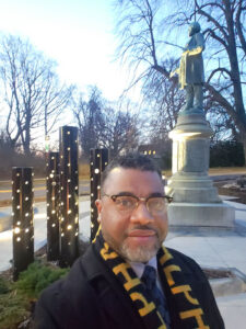 Rev.JuliusD. Jackson Jr. stands in front of the Frederick Douglass Plaza at South Avenue and Robinson Drive in Highland Park.
