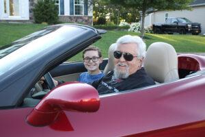 John Addyman in his Corvette with his grandson, Jeremy Loblaw.