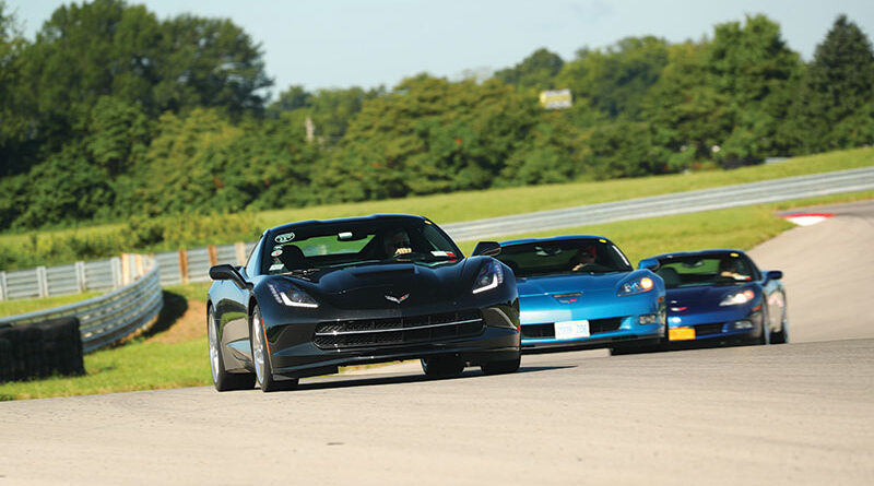 Members of the Rochester Corvette Club practice cleaning out their fuel injectors on the track in Bowling Green, K.Y. in August of 2019 at the end of a caravan from Rochester to the 25th Anniversary of the Corvette Museum.
