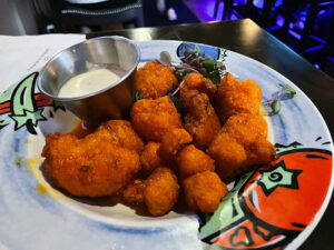 The cauliflower wings ($12): The combination of truffle and buffalo wing sauce is incredibly balanced.