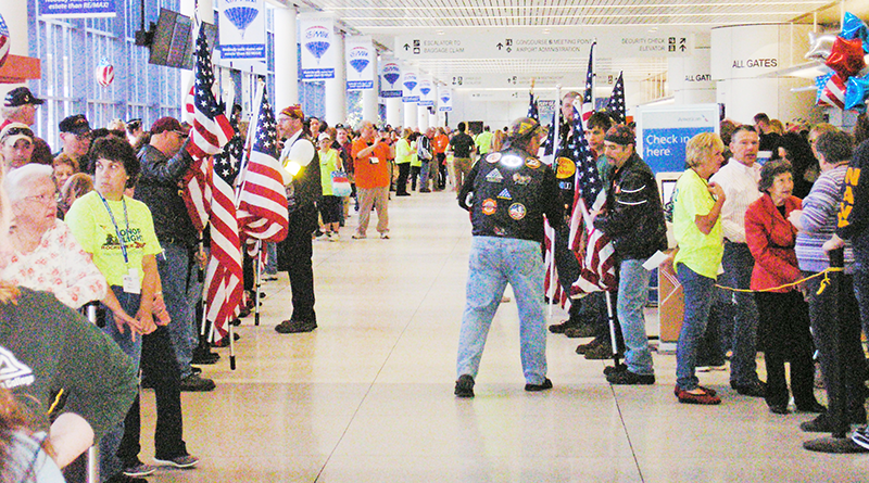 "Hundreds of friends and family members gathered April 8 at the Greater Rochester International Airport to welcome a group of 43 local veterans and their ""guardians"" after their return from a trip to Washington D.C. as part of Honor Flight Rochester program."