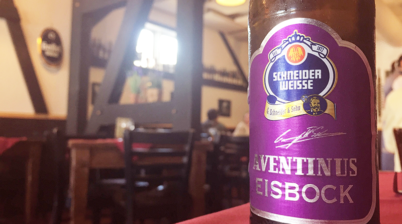 A bottle of Schneider Aventinus Eisbock and a glass of Berliner Weiss beer with a shot of raspberry syrup, the special of the house.