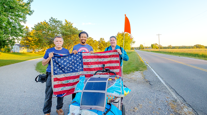 """Paul Bardotz of Palmyra (left) and Brent Walton of Chili (right) during their September trip on Route 66 between Chicago to California. They met """"G"""" (in the middle) who was walking on Route 66 from Los Angeles to Chicago. They met """"G"""" in rural Missouri."""