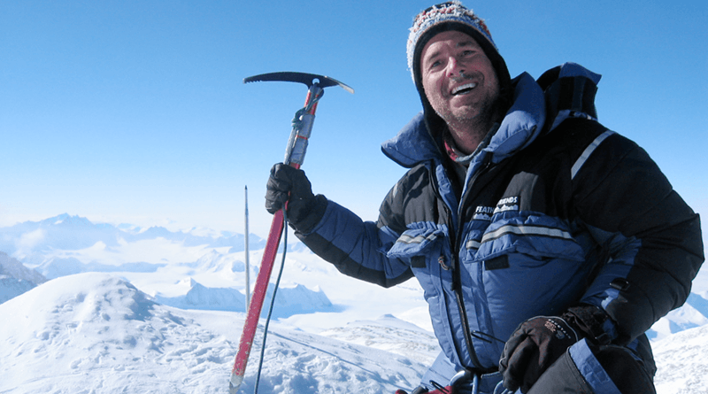 Kevin Flynn is all smiles atop Mt. Vinson. At 16,066 feet, it's the highest peak in Antarctica.