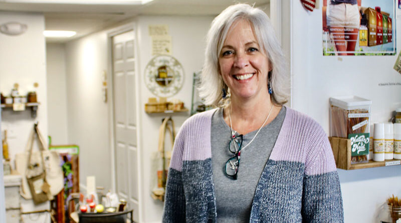"Amy Stringer, 55, of Ontario, quit her job as an accountant for a Victor firm to open her business, The North Bee in Webster. ""I have a joy doing this,"" she says."