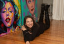 Photo by Michael Rivera. Lorraine Staunch with some of her portraits in her studio in Fairport.